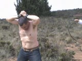 Furious bull whipping punishment outdoors by two dominas