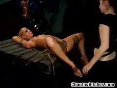 Lesbo mistress giving painful pleasure to a sub babe