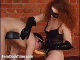 Red head strapon dominatrix
