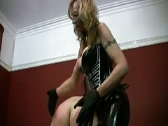 Kinky and brutal MILF gets tough with her strapon slave