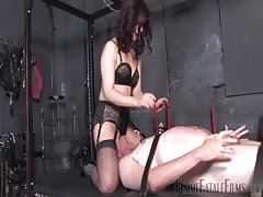 Slave suffer from a wicked brunette BDSM domination