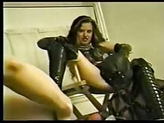 Vintage video with a femdom woman fucking man's ass