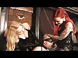 Latex mistresses trains slut slave with strapon
