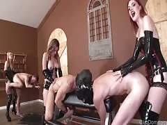 Three gorgeous strapon dominatrix with their slaves