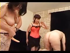 Mature mistress punishing her couple slaves