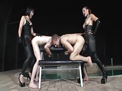 Vicious strapon mistresses pegging slaves