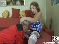 Angry smoking babe punishing a man using strapon