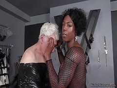 Cruel ebony face slapping and spitting to pathetic old man slave