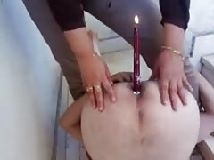 Candle lighting on his asshole