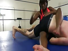 Strong black woman wrestles a whilte guy
